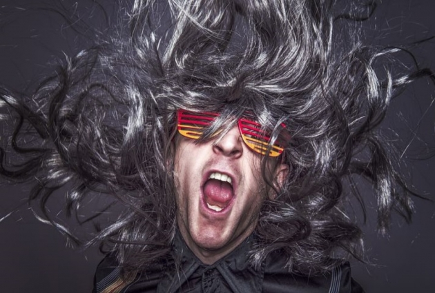 rockstar guy with long hair and colored glasses
