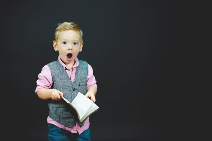 boy with the book surprised with the most read blog posts in 2017