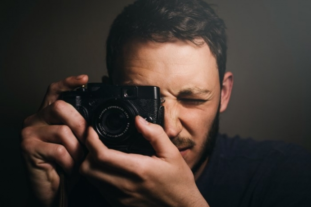 man holding a camera
