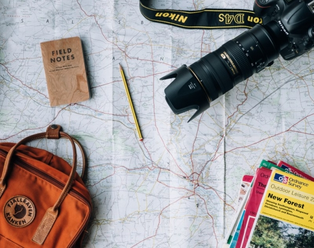 setting up a travel blog with a map, camera, notes and guides