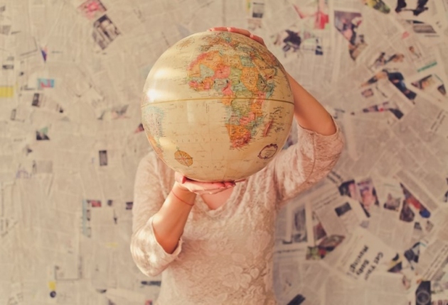 a girl looking around the globe