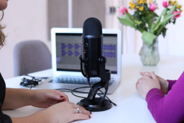 two-women-recording-a-podcast